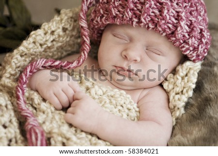 Sleeping baby wearing hat, soft focus with shallow depth of field - stock photo