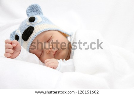 Sleeping baby with knitted hat