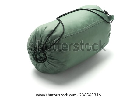 Sleeping Bag Packed In A Sack Lying On White Background  - stock photo