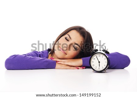 Sleeping beautiful woman with alarm clock  - stock photo