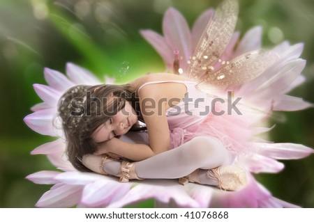 Sleeping beauty fairy on lily flower - stock photo