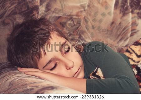Sleeping child.  Toned image. - stock photo