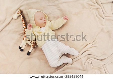 sleeping cute newborn baby, maternity concept, soft image of beautiful family