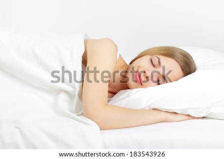 Sleeping Girl on the bed. on light background - stock photo
