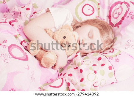sleeping girl with toy - stock photo