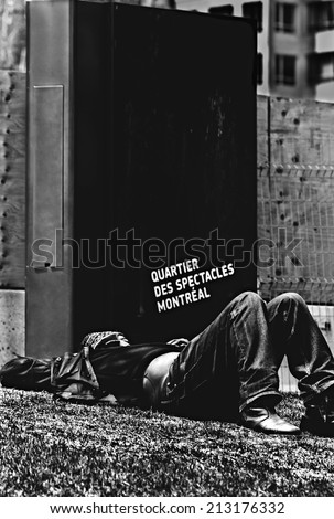 Sleeping homeless in downtown Montreal - stock photo