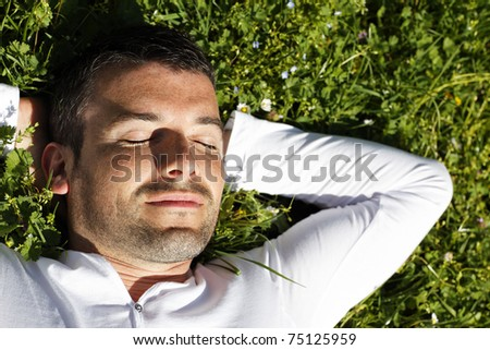 sleeping in the grass - stock photo