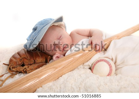 Sleeping Infant Boy Holding Baseball Bat and Ball on White Background - stock photo
