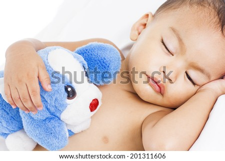 Sleeping little cute boy hugging a toy. - stock photo