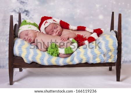 Sleeping little elves in a tiny bed.