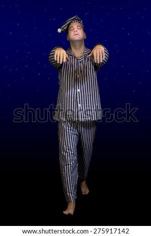 sleeping man walks in pajamas - stock photo