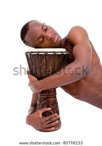 sleeping man with the african drum lies on a isolated white background - stock photo