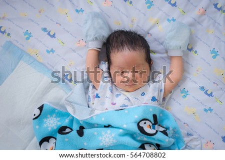sleeping newborn baby boy asian