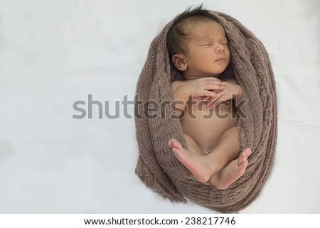 Sleeping newborn baby boy. Portrait of a newborn on white. - stock photo