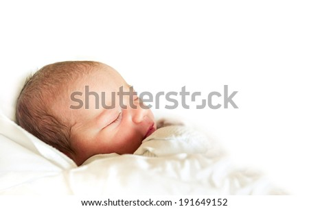 sleeping newborn baby in the hospital - the first hours of the new life - stock photo