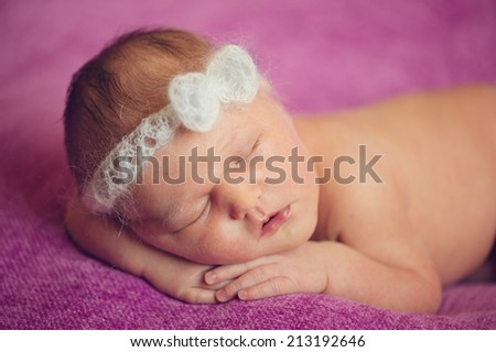 Sleeping Newborn Baby Naked on Hands and Blanket - stock photo