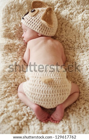 sleeping newborn wearing funny costume - stock photo