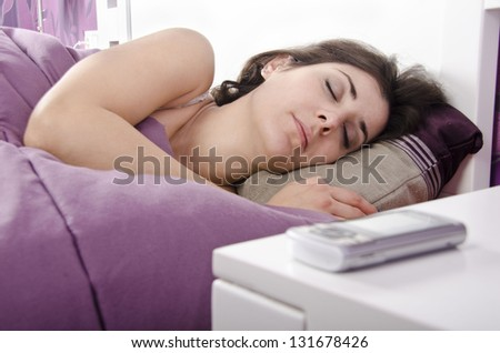 Sleeping next to phone (focus is in girl) - stock photo