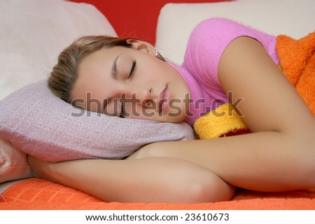 Sleeping teenage girl on the bad with light rose pillow - stock photo
