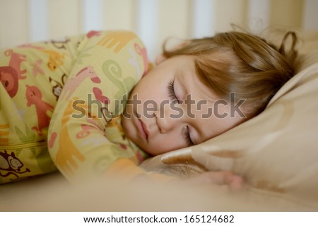 sleeping toddler girl wearing pajama