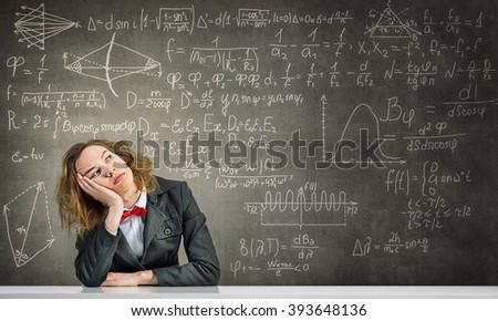 Sleeping woman in classroom - stock photo
