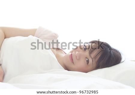 Sleeping young woman - stock photo