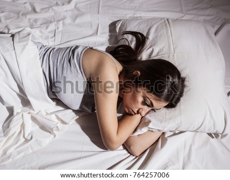 Sleepless woman lying in bed