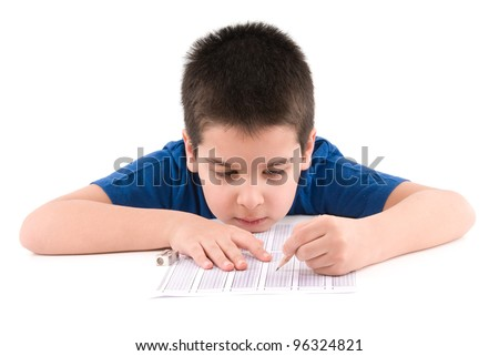 Sleepy boy taking a test isolated on white background. - stock photo