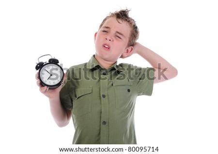 Sleepy boy with alarm-clock isolated on white background - stock photo