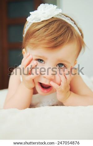 sleepy cute girl yawning on bed - stock photo
