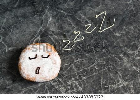 Sleepy donut, sleep sign, smile with zzz - stock photo