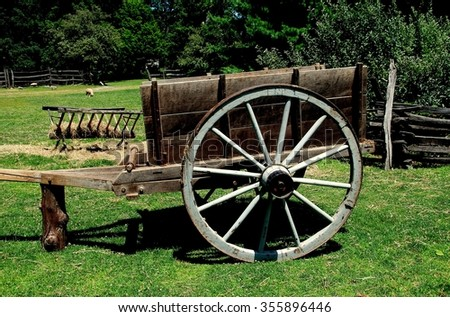 Sleepy Hollow, NY - July 9, 2009:   A wooden hay cart with large spoked wheels at the c. 1750 Philipsburg Manor farm