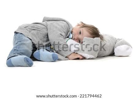 Sleepy kid with cuddle toy - stock photo