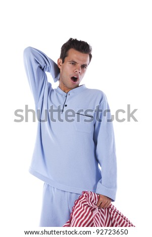 Sleepy young man with his pillow - stock photo