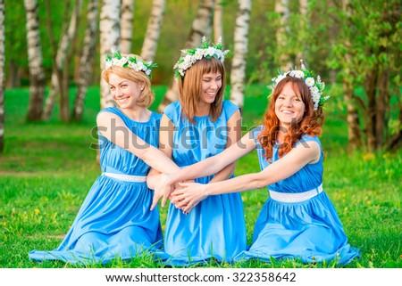 slender beautiful girls laughing at sunset in nature - stock photo