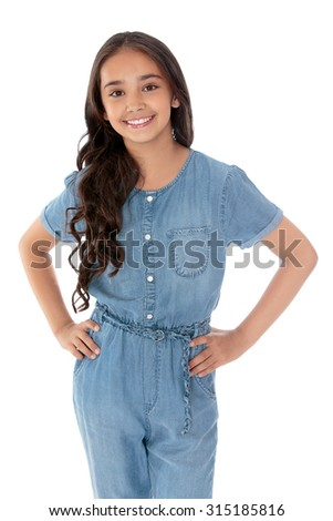 Slender elegant dark-haired girl Oriental appearance,school age, dressed in denim overalls. Closeup-Isolated on white background - stock photo