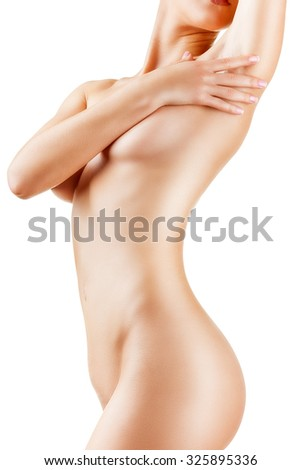 Slender figure of a woman with perfect skin isolated on white background - stock photo