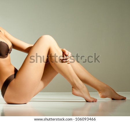 slender girl in a bikini - stock photo