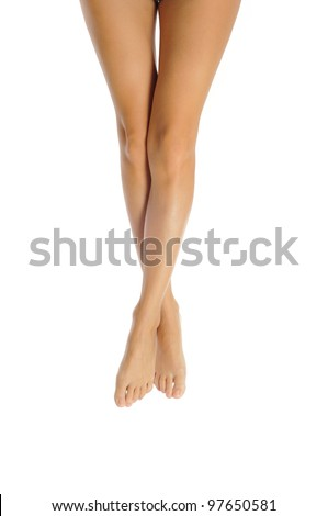 slender healthy female legs isolated on white background - stock photo