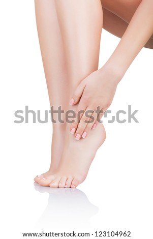Slender legs of a young woman isolated on white background - stock photo