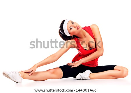 Slender sportive woman doing stretching. Isolated over white background.