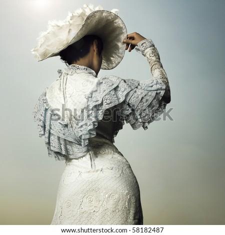 Slender woman in vintage dress for promenade - stock photo