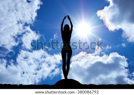 slender woman silhouette on a sunny day. - stock photo