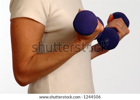 slender woman working with dumbbells - stock photo