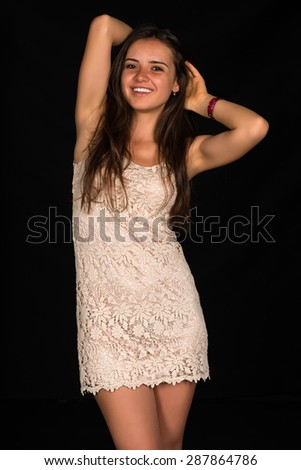 Slender young Romanian woman in a beige dress - stock photo