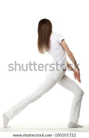 Slender young woman doing sport exercises on white background - stock photo