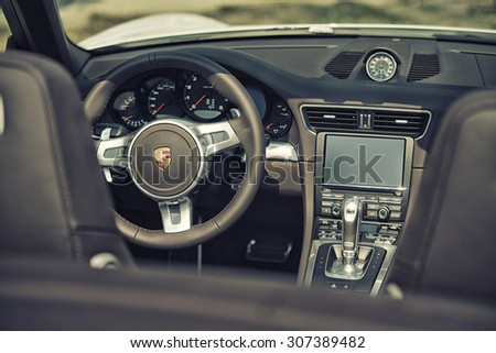 Sleza, Poland, August 15, 2015: Close up on Porsche 911 carrera s car steering wheel and cockpit  Motorclassic show on August 15, 2015 in the Poland - stock photo