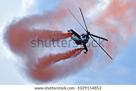 Sliac, Slovakia August. 27. 2017. Slovak International Air Fest SIAF 2017 - Czech Air Force MIL MI-24V / Mi-35 helicopter (3366) red smoke Pilot – Capt. Michal Bystrican