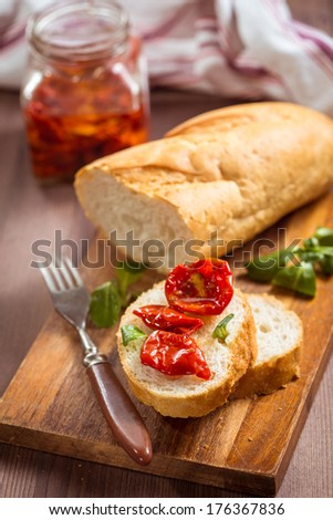 Slice baguette with sun-dried tomatoes in olive oil