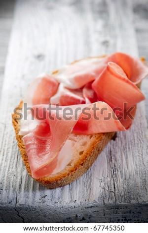 slice bread with parma ham - stock photo